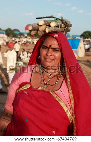 PUSHKAR, INDIA - NOVEMBER 18: A traditional Rajasthani woman at Pushkar Fair on November 18, 2010.  Pushkar fair is held annually in Rajasthan to trade camels, horses and cattle - stock photo