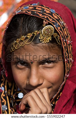 PUSHKAR, INDIA - NOVEMBER 21: An unidentified girl attends the Pushkar fair on November 21, 2012 in Pushkar, Rajasthan, India. Pilgrims and camel traders flock to the holy town for the annual fair.