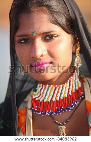PUSHKAR, INDIA - NOVEMBER 19: An unidentified girl attends the Pushkar fair on November 19, 2010 in Pushkar, Rajasthan, India. Pilgrims and camel traders flock to the holy town for the annual fair.
