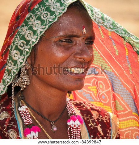 PUSHKAR, INDIA - NOVEMBER 19: An unidentified woman attends the Pushkar fair on November 19, 2010 in Pushkar, Rajasthan, India. Pilgrims and camel traders flock to the holy town for the annual fair.