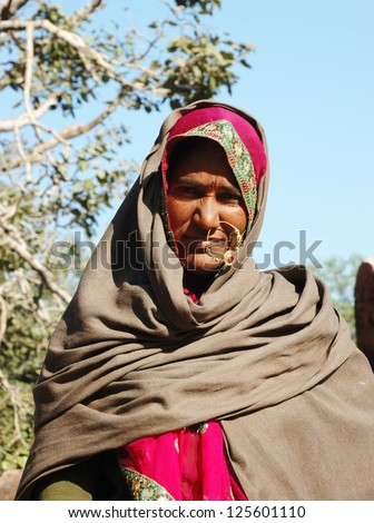PUSHKAR, INDIA - NOVEMBER 29: Portrait of old unidentified rajasthani woman who is leaving annual camel mela holiday in Pushkar on November 29,2012 in Pushkar, Rajasthan,India