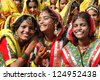 PUSHKAR, INDIA - NOVEMBER 21: Unidentified indian girls are preparing to dance  at annual Thar desert camel fair in Pushkar on November 21,2012 in Pushkar,Rajastan,India - stock