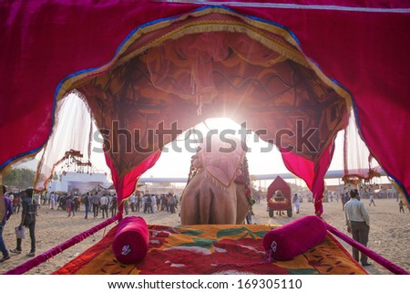 PUSHKAR, INDIA - NOVEMBER 15: Unidentified people are having fun at amusement park during traditional camel mela in Pushkar on November15 ,2013 in Pushkar, Rajasthan, India - stock photo