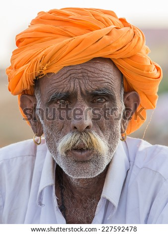 PUSHKAR, INDIA - OCTOBER 28, 2014: Unidentified Indian man attended the annual Pushkar Camel Mela. This fair is the largest camel trading fair in the world. - stock photo