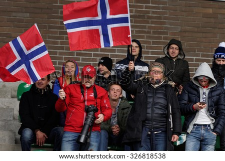 PUSHKIN, LENINGRAD OBLAST, RUSSIA - OCTOBER 10, 2015: Norwegian fans support their team during the qualifying match of European Championship 2016 in American football. Russia won the match 20:0 - stock photo
