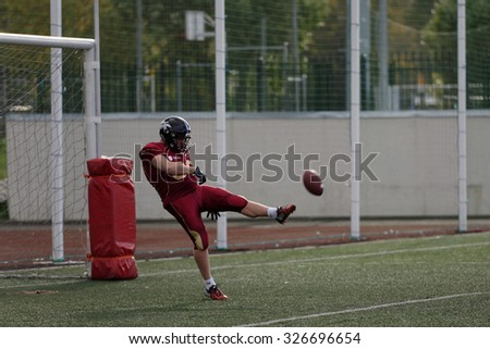 PUSHKIN, LENINGRAD OBLAST, RUSSIA - OCTOBER 10, 2015: Player of team Russia kick the ball during qualifying match of American Football European Championship 2016 against Norway. Russia won the match - stock photo