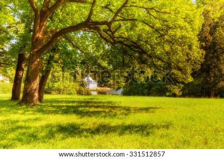 Pushkin, Saint Petersburg/Russia - August 11, 2015: View of park in Pushkin in summer day ('Grotto' Pavilion behind lawn and trees)