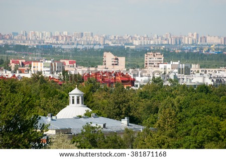 Pushkin. Saint - Petersburg. Russia. Top view of Cupola the Roman Catholic Church John the Baptist and residential houses of the town. On the background are residential houses of Saint - Petersburg. - stock photo