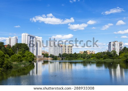 PUSHKINO, RUSSIA - on JUNE,18, 2015. River Serebryanka. New multystoried houses and its reflection in the water