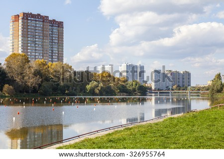 PUSHKINO, RUSSIA - on SEPTEMBER 15, 2015. Autumn landscape. Multystoried houses on the river bank of Serebryanka