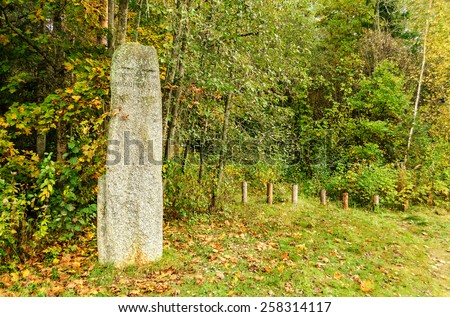 PUSHKINSKIYE GORY, RUSSIA - SEPTEMBER 28.  Stone pointer labeled Pushkin Reserve Mikhailovskoye on the way to the estate of the poet on September 28, 2013.