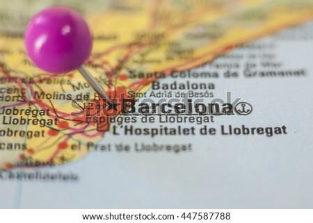 Pushpin marking on Barcelona, Spain. Selective focus on city - stock photo