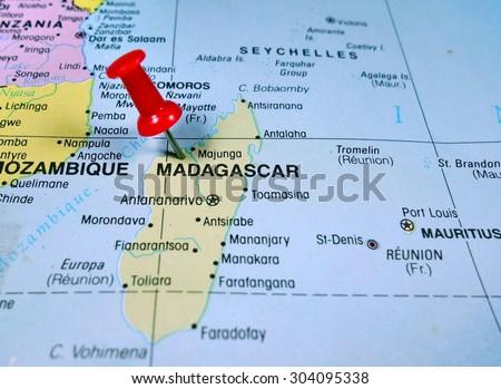 pushpin marking on Madagascar map - stock photo
