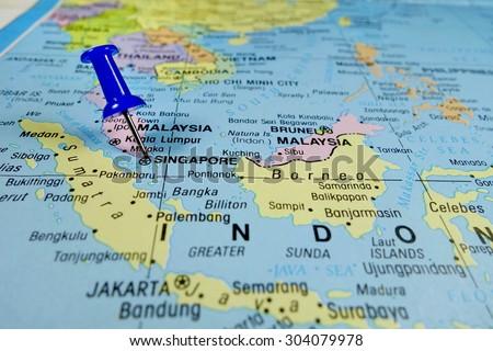 pushpin marking on Singapore map - stock photo