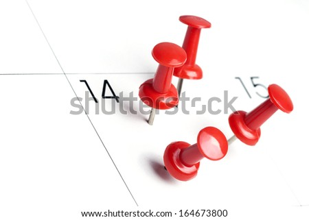 Pushpins on calendar, Important date or meeting appointment reminder concept. Copy space for text included. - stock photo