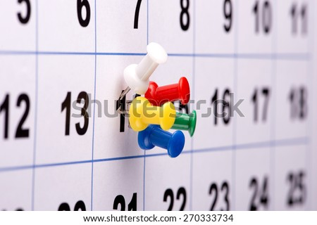 Pushpins on calendar-plan you appointment - stock photo