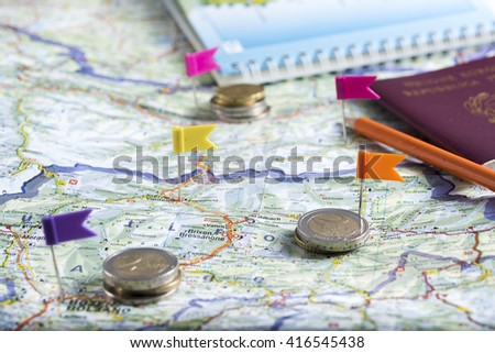 pushpins on the geographical map to plan a trip. - stock photo