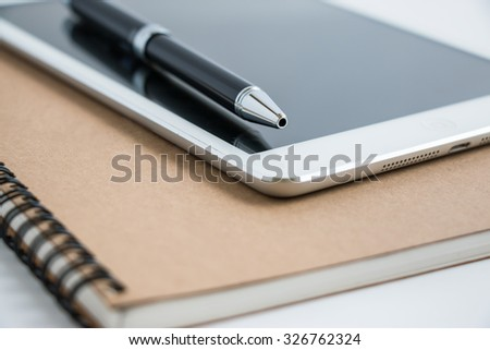 Put a pen on tablet and notebook. Stop to work close and shutdown everything.