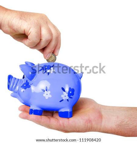 Put money in piggy bank - stock photo