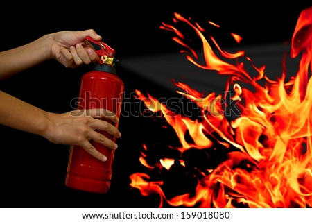 put out the fire with fire extinguisher - stock photo