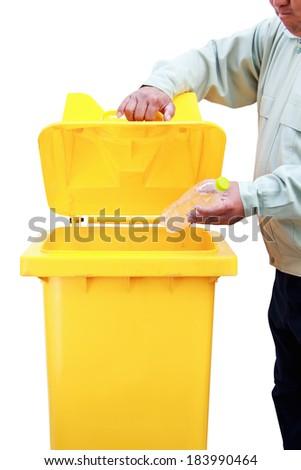 Put plastic bag into recycle bin - stock photo