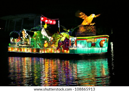 PUTRAJAYA - JULY 7: A decorated boat representing Langkawi Island, Malaysia takes part in the float parade of the Floria Putrajaya 2012 festival on the lakes of Putrajaya, Malaysia on July 7, 2012.