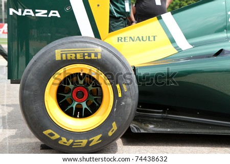 PUTRAJAYA, MALAYSIA - APRIL 2: Closeup of F1 tyre from Team Lotus at street demonstration April 2, 2011 in Putrajaya, Malaysia. The event is a promotion for F1 Malaysia Grand Prix 2011. - stock photo