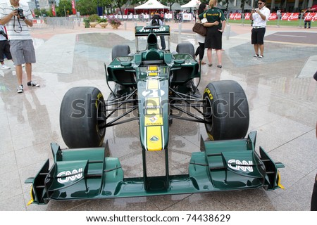 PUTRAJAYA, MALAYSIA - APRIL 2: Front view of F1 Car from Team Lotus at street demonstration April 2, 2011 in Putrajaya, Malaysia. The event is a promotion for F1 Malaysia Grand Prix 2011.