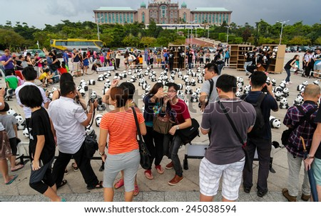 PUTRAJAYA, MALAYSIA - DEC 23, 2014: Family and friends visiting the 1600 Pandas campaign organised by WWF - Malaysia. This is to pass on the important message of environmental preservation. - stock photo
