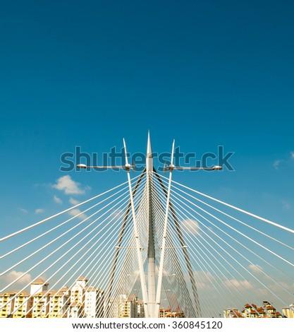 PUTRAJAYA, MALAYSIA - JAN 10,2016: Seri Wawasan Bridge on JAN 10, 2016 in Putrajaya. It is a 370m long bridge which is built across the Putrajaya Lake in Putrajaya, Malaysia.  - stock photo