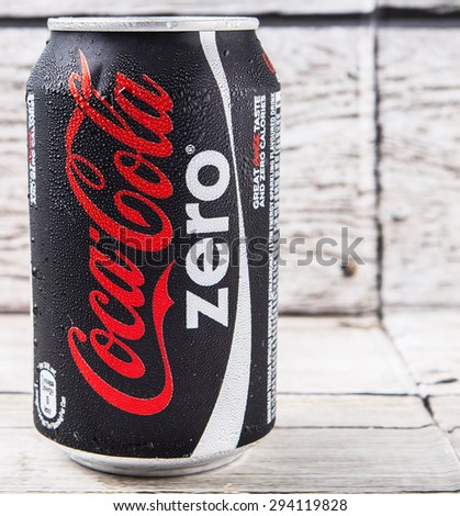 PUTRAJAYA, MALAYSIA - JULY 5TH, 2015. Coca Cola Zero on weathered wood. Coca Cola drinks are produced and manufactured by The Coca-Cola Company, an American multinational beverage corporation.