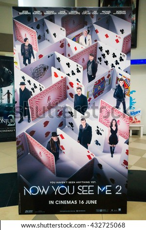 PUTRAJAYA, MALAYSIA - June 4, 2016: Now You See Me 2 poster displayed at Alamanda Putrajaya Mall. Its a sequel about the Four Horsemen return mind-bending adventure stage illusion around the globe. - stock photo