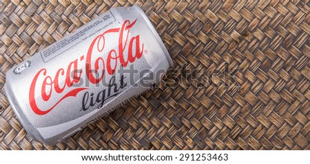 PUTRAJAYA, MALAYSIA - JUNE 28TH, 2015. Coca Cola Diet on wicker background. Coca Cola drinks are produced and manufactured by The Coca-Cola Company, an American multinational beverage corporation.