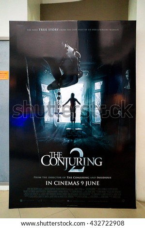 PUTRAJAYA, MALAYSIA - June 4, 2016: The Conjuring 2 poster displayed at Alamanda Putrajaya Mall. The Conjuring 2 is the sequel about paranormal investigators to assist on the  poltergeist activity - stock photo