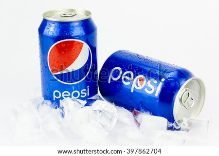 PUTRAJAYA, MALAYSIA - MAC 26, 2016. Two Pepsi Cans with ice Isolated On White. Pepsi is one of most popular soft drink among teenagers. - stock photo