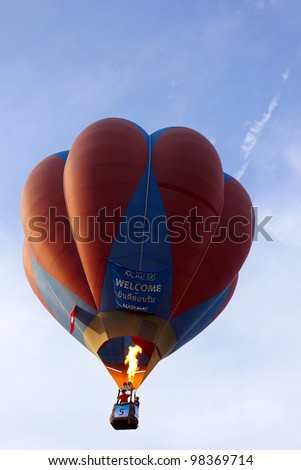 PUTRAJAYA, MALAYSIA - MAR 19 : A hot air balloon from Switzerland in flight at the 4th Putrajaya International Hot Air Balloon Fiesta on 19 Mar, 2012 in Putrajaya. 23 balloons participate in this year - stock photo