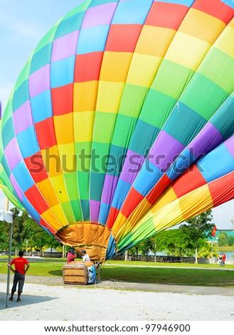 PUTRAJAYA, MALAYSIA-MAR 17: Hot air balloon being shut down at the 4th Putrajaya International Hot Air Balloon Fiesta 17 Mar, 2012 in Putrajaya. - stock photo