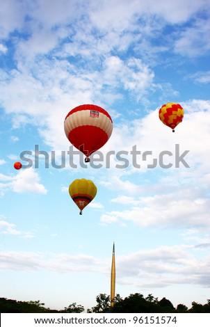 PUTRAJAYA, MALAYSIA-MAR 18:Hot air balloon in flight at the 3rd Putrajaya International Hot Air Balloon Fiesta 18 Mar, 2010 in Putrajaya. 29 balloon from 13 countries participate in this year event - stock photo