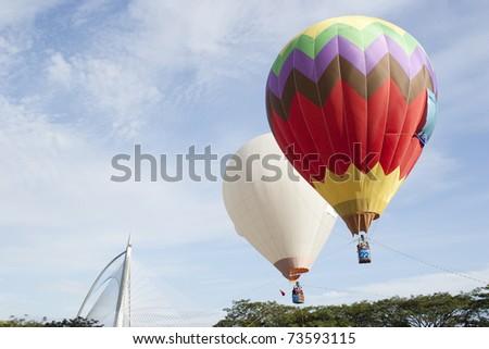 PUTRAJAYA, MALAYSIA-MAR 20:Tethered hot air balloon rides for visitor at the 3rd Putrajaya International Hot Air Balloon Fiesta Mar 20, 2011 in Putrajaya.More than 300,000 people visit this year event - stock photo
