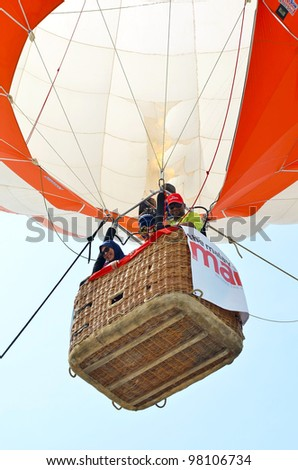 PUTRAJAYA, MALAYSIA-MAR 17:Unidentified visitors in balloon basket going fly on sky at the 4th Putrajaya International Hot Air Balloon Fiesta on Mar 17, 2012 Putrajaya, Malaysia. - stock photo