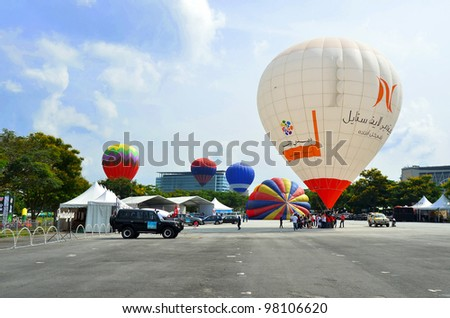PUTRAJAYA, MALAYSIA-MAR 17:View of various type hot air balloon at the 4th Putrajaya International Hot Air Balloon Fiesta on Mar 17, 2012 Putrajaya. The event held in Precinct 2, Putrajaya, Malaysia. - stock photo