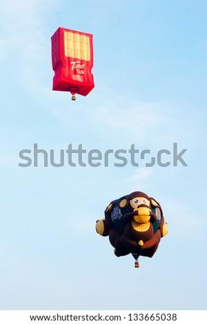 PUTRAJAYA, MALAYSIA-MARCH 29 :Balloons from Malaysia and USA in flight at the 5th Putrajaya International Hot Air Balloon Fiesta March 29, 2013 in Putrajaya. - stock photo