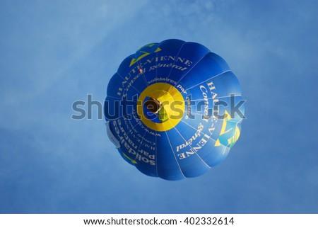 PUTRAJAYA, MALAYSIA - MARCH 22: Blue hot air balloon flies during the 1st International Hot Air Balloon Fiesta in Putrajaya, Malaysia on March 22, 2009. - stock photo