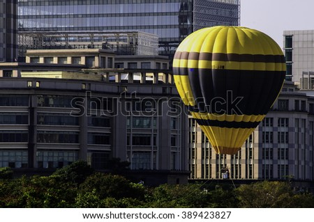 PUTRAJAYA, MALAYSIA - MARCH 12:Colourful hot air balloons floating over sunrise skies at the 5th Putrajaya International Hot Air Balloon Fiesta in Putrajaya, Malaysia on March 12, 2016