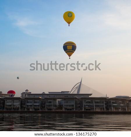PUTRAJAYA, MALAYSIA - MARCH 30:Colourful hot air balloons floating over Wawasan bridge at the 5th Putrajaya International Hot Air Balloon Fiesta in Putrajaya, Malaysia on March 30, 2013 - stock photo