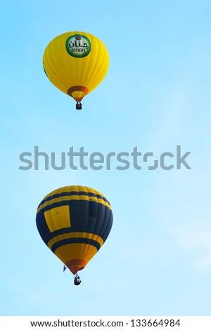 PUTRAJAYA, MALAYSIA-MARCH 29: Hot air balloons in flight at the 5th Putrajaya International Hot Air Balloon Fiesta 29 March, 2013 in Putrajaya. - stock photo