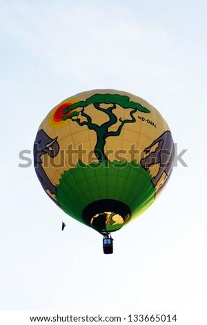 PUTRAJAYA, MALAYSIA-MARCH 29: Michael Brammen (Germany) in flight at the 5th Putrajaya International Hot Air Balloon Fiesta on March 29, 2013 in Putrajaya, Malaysia. - stock photo