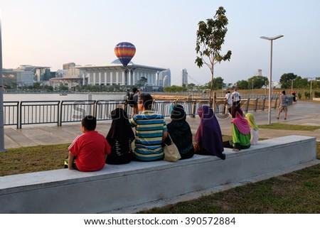 PUTRAJAYA, MALAYSIA - MARCH 12: People enjoying hot air balloon show at the 8th Putrajaya International Hot Air Balloon Fiesta in Putrajaya, Malaysia on March 12, 2016. - stock photo