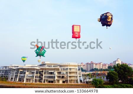 PUTRAJAYA, MALAYSIA-MARCH 29 :Variety of balloons take flight at the 5th Putrajaya International Hot Air Balloon Fiesta March 29, 2013 in Putrajaya. Over 250,000 people attended the event. - stock photo