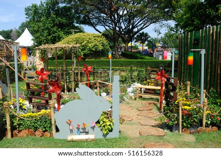 PUTRAJAYA, MALAYSIA -MAY 30, 2016: Small pocket garden made from mix of recycle material and flower at Floria Garden, Putrajaya, Malaysia.